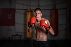 Young teenager kick boxer in the gym