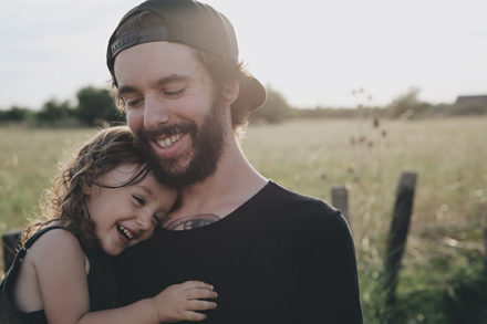 Man smiling with daughter
