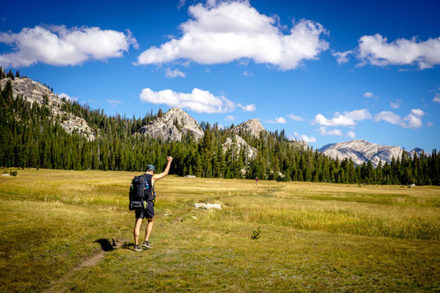 Hiking Man With Fist In the Air
